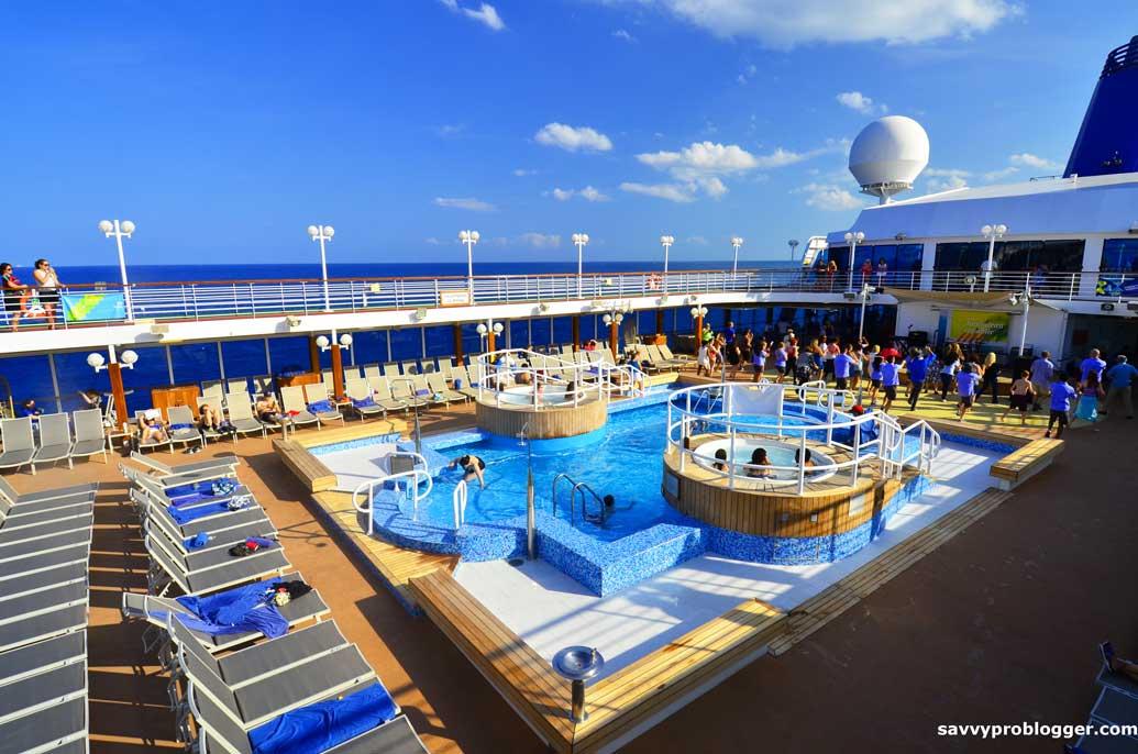 crew entertaining passengers on cruise ship